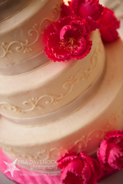 White cake with fuschia flowers